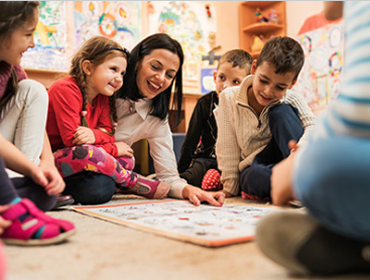image of teacher playing games with children